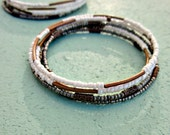 Adjustable Beaded Ivory and Dark Silver Glass Memory Wire Bangle Bracelet with Rustic Brass Accents: Glimpse