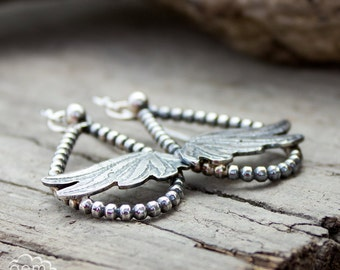 Sterling silver teardrop bohemian style earrings with Etched wings - With these wings -