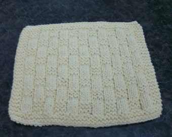 Hand Knit Cotton Dishcloth - pale yellow in color - measures approximately 8x9 inches