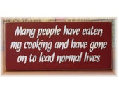 Many people have eaten my cooking and have gone on to lead normal lives primitive sign