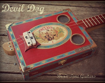 Devil dog cigar box slide guitar
