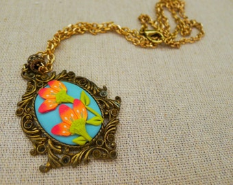 Blue, green, orange, salmon floral pendant with vintage-type metal setting