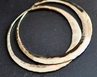 14k gold hoops, large wide yellow gold hoop earrings, mirror finish, smooth texture,