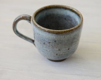 A Wheel Thrown Stoneware Clay Coffee cup or mug