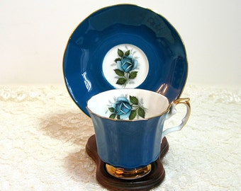 Elizabethan Fine Bone China, English Teacup and Saucer, Teal Blue With Gold Trim, Blue Rose Interior