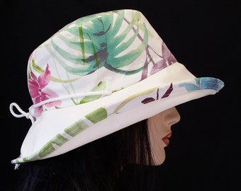 Sunblocker - Creamy White and Pastel tropical flowers and ferns large brim sun hat with adjustable fit