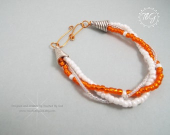 Bracelet · Three Strand Braided Beads · Orange and White · UT Vols · University of Tennessee Volunteers · SEC Jewelry · Collegiate Jewelry