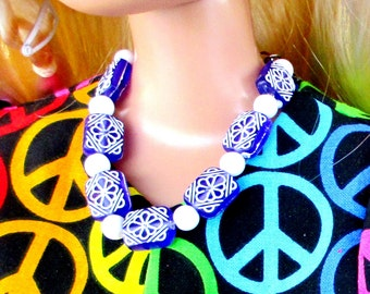 28 inch Barbie with a sweet deep purple  and white necklace set.