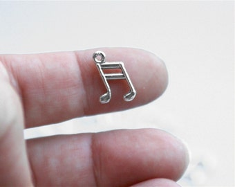 Music charm,  qty 10, silver tone.  Tiny 10x14mm eighth notes. For necklaces, earrings charm bracelets. Music band orchestra 8th. (1-17a)
