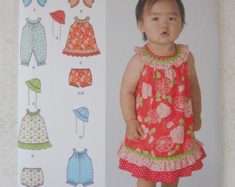 Simplicity 1700  Babies Dress, Romper in Two Lengths, Panties, Jacket and Hat Size XXS - L New - Uncut