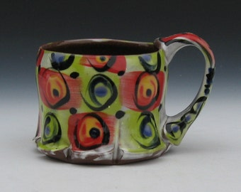 checkered mug with circles red, lime green, blue, black, white, fun colorful pottery