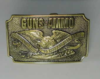 1978 GUNS and AMMO Brass Belt Buckle. The Great American Buckle Co. Chicago.