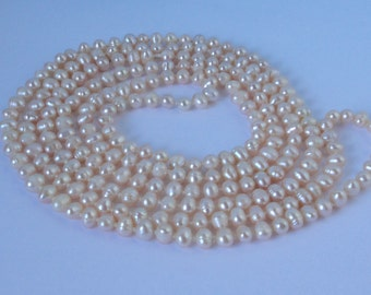 Super Long Hand Knotted, Cultured Fresh Water Pearls Necklace. 65 inches L.