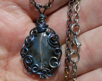Black Labradorite cat's eye cabochon pendant, natural stone from Ukraine,  hand wrapped  in titanium  filigree setting