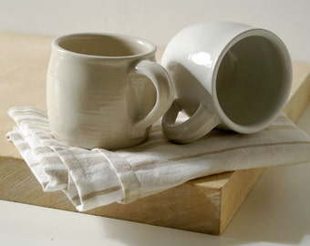 Two stoneware pottery mini mugs - glazed in simply clay and white