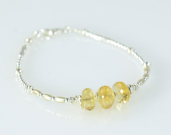 Citrine faceted beads and sterling silver beads  bracelet