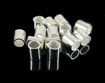 """2mm inside diameter, size 4 silver plated crimp tubes, 2 grams (~ 42- 44 pcs). 2.5mm wide by 3mm high. Use with .030"""" wire. Large crimps"""