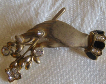 Vintage brooch, ladies hand with bouquet of flowers