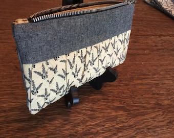 Ruffle clutch with chunky zipper