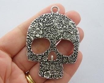 2 Skull pendants antique silver tone HC7