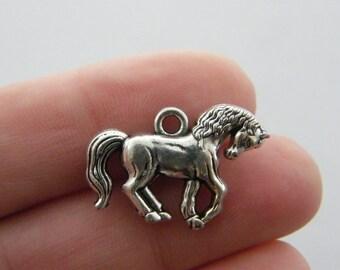 4 Horse charms antique silver tone A8