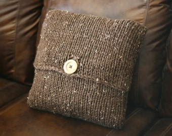 Super-chunky knit pillowcase with wood button in brown tweed