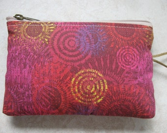 rich red padded makeup jewelry bag with sunburst print
