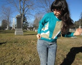 80s avant garde sweater - teal with abstract white and tan pattern