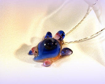 Very blue sparkley turtle necklace.