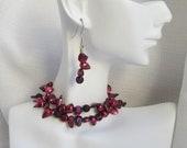 Deformed burgundy pearls make an unusual necklace