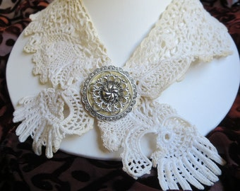 Delicate handmade antique lace with silver and mother of pearl