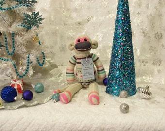 Carol, the Tan Sock Monkey Stuffed Animal in a Striped Sweater
