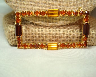 1992 Topaz and Citrine Jewel Like Pin.