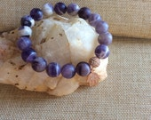 "Amethyst stone bracelet with rose gold Hamsa Hand , 7"" stretchy, 10mm matte Amy stones"