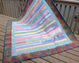 Sea Glass Race 75x84 batik quilt in colors of bright pastels