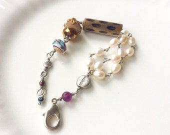 Destiny bracelet.  White pearl wire wrapped gift. czech glass, lamp work, wood evil eye beads.