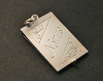 Vintage Georg Jensen silver charm.  Note book charm. Sterling silver