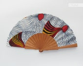 Spanish hand fan - Waves in white - red and yellow wax print accessory