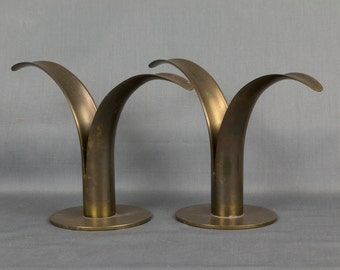 A pair of Brass Candle stick holders, Mid Century, Signed Ystad Metall, Sweden. Designed by Ivar Alenius-Bork, Signed by the artist