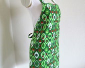 Christmas Apron- SALE A Vibrant Green Print covered with Reindeer, Christmas Trees, Bells, Ornaments,Great for making your holiday goodies
