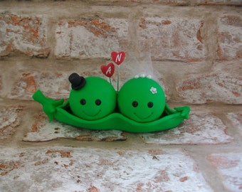 Peapod bride and groom wedding cake topper