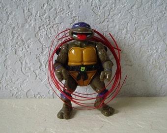 Teenage Mutant Ninja Turtle, Talking Donatello with three talking strips, 1991. Rare
