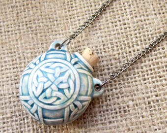 Celtic knotwork bottle necklace - blue & cream ceramic knot pattern