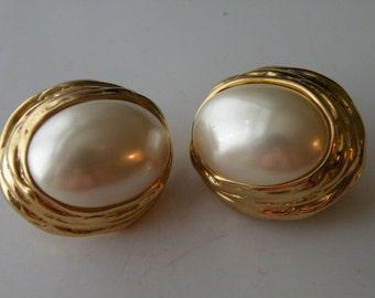 Ciner faux pearls gold plate metal clip-on earrings.