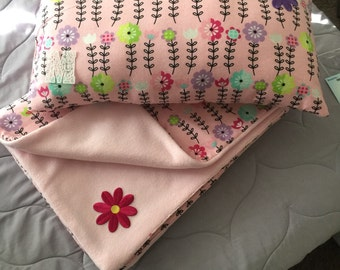 Pink baby blanket with flowers and pillow