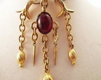 Victorian gold filled charm brooch with garnet tone stone