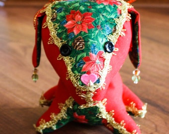 Decorated Stuffed Dog in Christmas Red, Green, Gold and Poinsettias