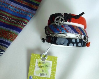 Textile, multi-stranded bracelet that wraps around the wrist and made two bracelets in one!