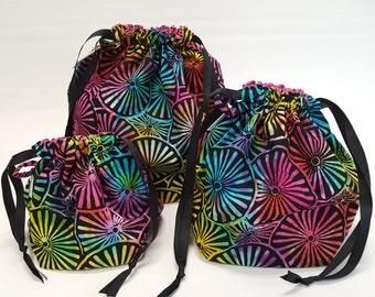Square bottom drawstring bags in Sunburst in three sizes - Reversible