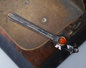 Vintage sterling silver 875 tie bar clip. Sword with ethnic decor, pressed Baltic amber stone